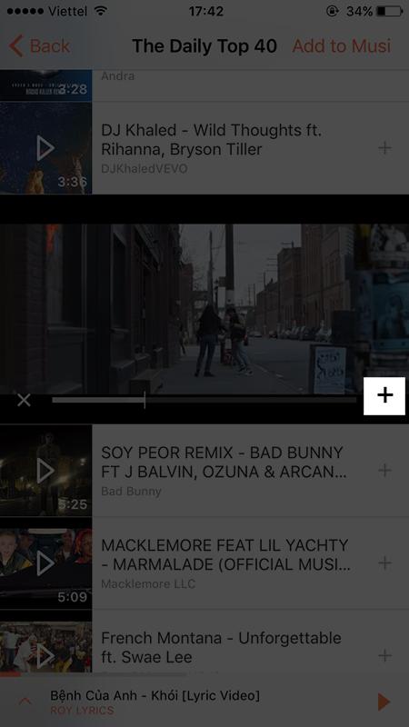 nhấn vào biểu tượng dấu + tại video bài hát đang mở